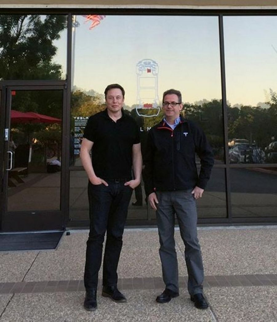 Dr. Martin Ferch, Director of Business Development (right), with Tesla CEO Elon Musk