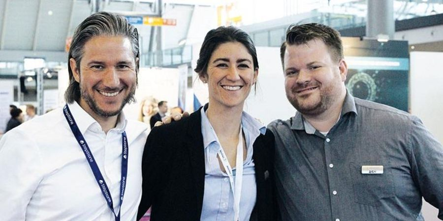 Three business leaders: CEO Nils Wagener (left); Gabriela Vicky Rombach, KÖNIGSTEINER Creative (center); Benjamin Kautz, KÖNIGSTEINER Digital (right)